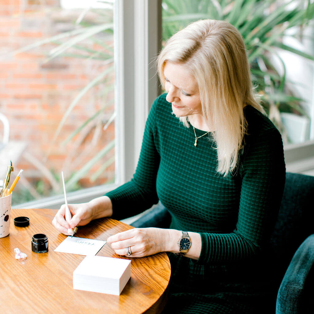 Laura Prudence creating sophisticated dip pen calligraphy.