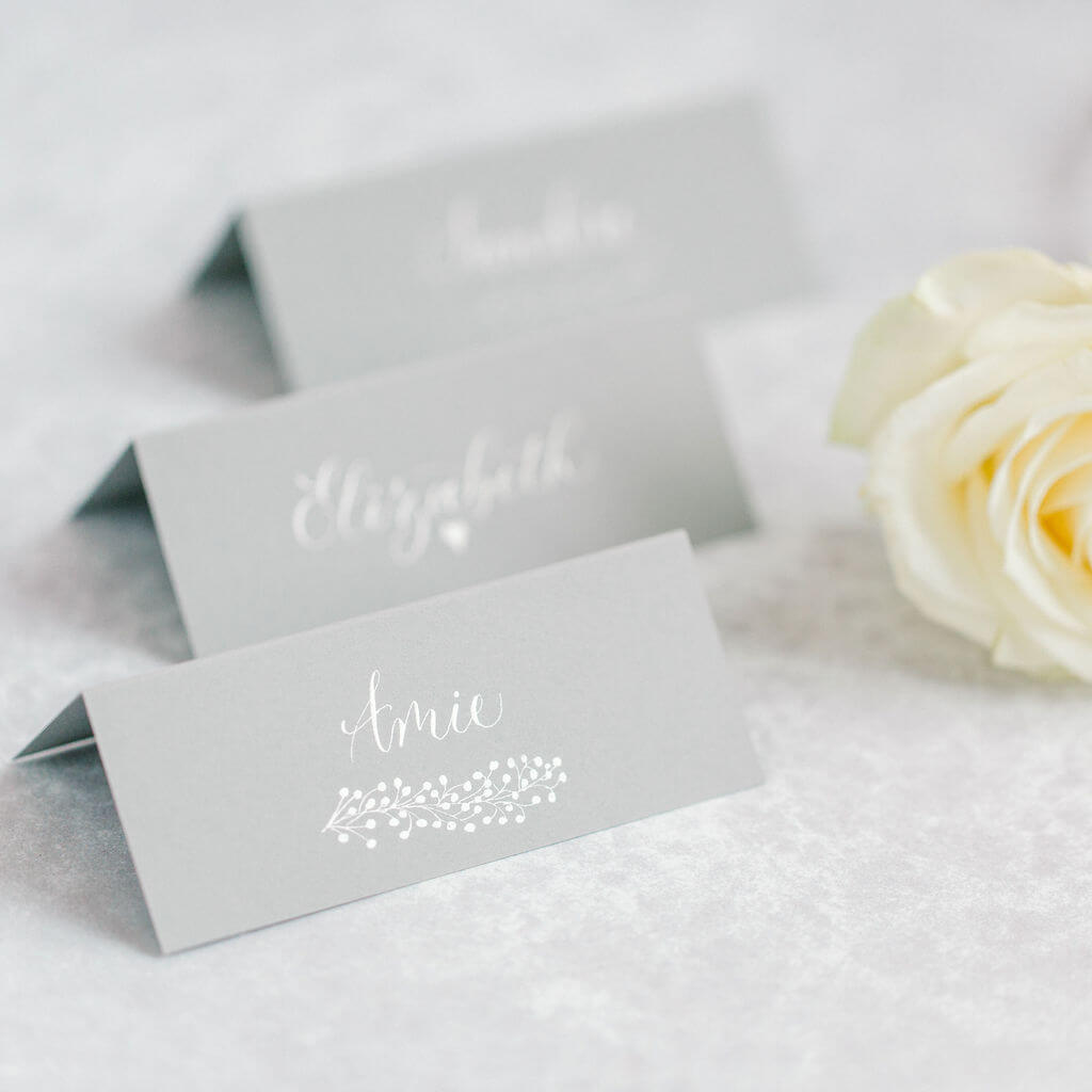 Sophisticated grey place cards created in delicate calligraphy on luxury card.