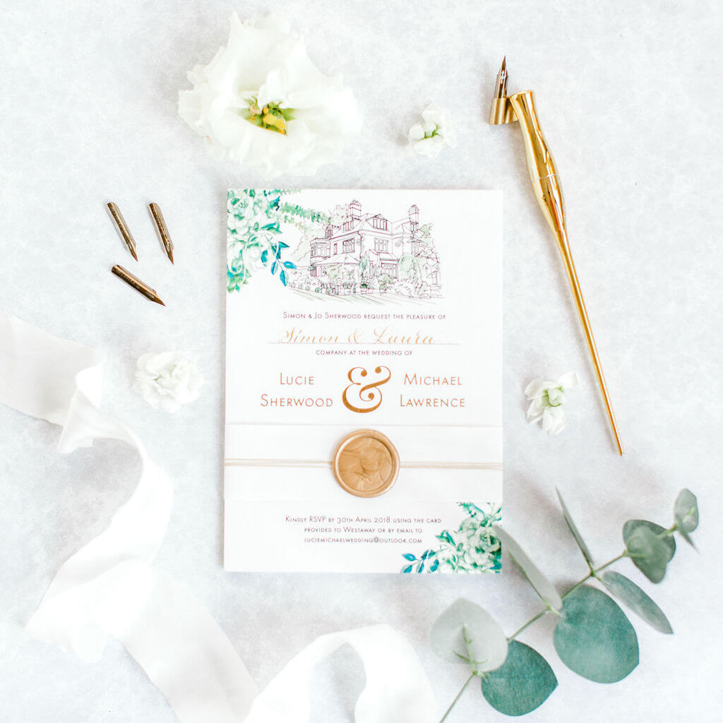 Delicate gold calligraphy names created on a sophisticated wedding invitation.